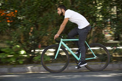 Cyclist man riding fixed gear sport bike Stock Image