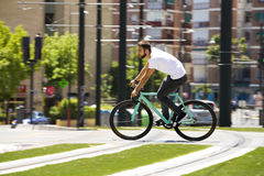 Cyclist man riding fixed gear sport bike. In sunny day on a city Royalty Free Stock Photos