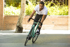 Cyclist man riding fixed gear sport bike. In sunny day on a city Stock Photo