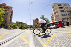 Cyclist man riding fixed gear sport bike. In sunny day on a city Royalty Free Stock Images