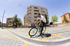 Cyclist man riding fixed gear sport bike. In sunny day on a city Stock Image