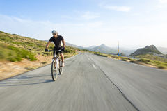 Cyclist man riding mountain bike Royalty Free Stock Photo