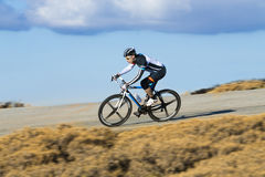 Cyclist man riding mountain bike Royalty Free Stock Images