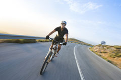 Cyclist man riding mountain bike in sunny day Royalty Free Stock Photos
