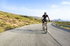 Cyclist man riding mountain bike in sunny day Royalty Free Stock Image