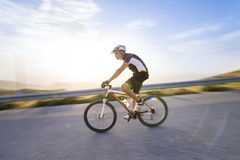 Cyclist man riding mountain bike in sunny day Stock Photography