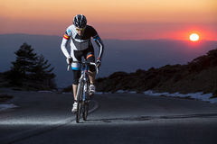 Cyclist man riding mountain bike at sunset Royalty Free Stock Images