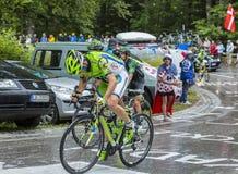 The Cyclist Marco Marcato - Tour de France 2014. Le Markstein, France- July 13, 2014: The Italian cyclist Marco Marcato  climbing the road to mountain pass Le Stock Photos