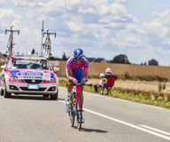 The Cyclist Marco Marzano. Beaurouvre,France,July 21st 2012:The Italian cyclist Marco Marzano from Lampre-Merida Team pedaling during the 19th stage of Le Tour Royalty Free Stock Photography