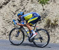 The Cyclist Matteo Tosatto. Chorges, France- July 17, 2013: The Italian cyclist Matteo Tosatto from Saxo-Tinkoff Team pedaling during the stage 17 of 100th Royalty Free Stock Photography