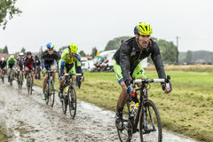 The Cyclist Matteo Tosatto on a Cobbled Road - Tour de France 20 Stock Photography