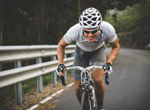 Cyclist in maximum effort Stock Images