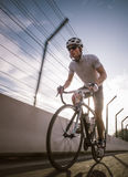 Cyclist in maximum effort in a road outdoors Stock Photo