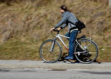Cyclist. Men on bike with blurred background with shadow on the road royalty free stock photography
