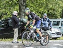 The Cyclist Michael Albasini - Tour de France 2014. Le Markstein, France- July 13, 2014: The Swiss cyclist Michael Albasini of Orica-GreenEDGE team climbing the Stock Photos