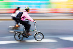 Cyclist in motion blur in the city traffic of London, UK Stock Image