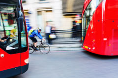 Cyclist in motion blur in the city traffic of London, UK Royalty Free Stock Photos
