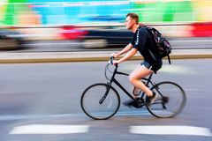 Cyclist in motion blur in the city traffic of London, UK Stock Photography