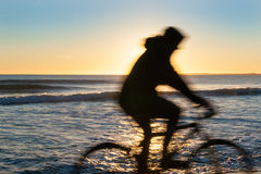 Cyclist in motion blur silhouette Royalty Free Stock Photos