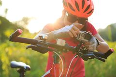 Cyclist mount the action camera on bike Stock Image