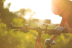 Women cyclist mount the action camera on mountain bike Royalty Free Stock Photos
