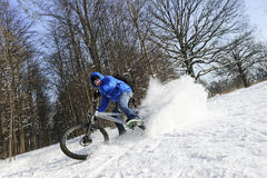 Cyclist on mountain bicycle stock image