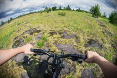Cyclist on a Mountain Bike on a forest track. Photographed on a fisheye lens Royalty Free Stock Photography