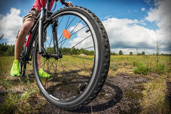 Cyclist on a Mountain Bike on a forest track. Photographed on a fisheye lens. focus on the front wheel Stock Photo
