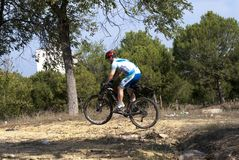 Cyclist on mountain bike racing making a career in the field Royalty Free Stock Image