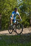 Cyclist on mountain bike racing making a career in the field Royalty Free Stock Photography