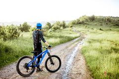 Cyclist on the mountain road stock images
