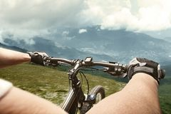 Cyclist in mountains Stock Photography