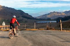 Cyclist near Blea Tarn in the Lake District royalty free stock images
