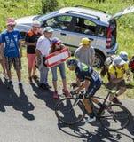 The Cyclist Nelson Oliveira - Tour de France 2016. Col du Grand Colombier,France - July 17, 2016: The Portuguese cyclist Nelson Oliveira of Movistar Team riding Stock Image