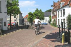 Student is cycling in the walled old town of Amersfoort,Netherlands Royalty Free Stock Photos