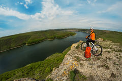 Cyclist in Orange Wear Riding the Bike above River Royalty Free Stock Image