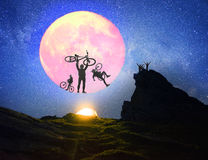 Cyclist and overnight on the rocks stock photos