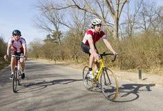 Cyclist overtaking Stock Image