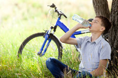 cyclist in the park drinking clean water Stock Image