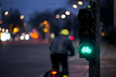 Cyclist passes bicycle traffic light.  Stock Photos