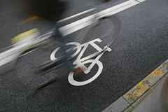 Cyclist passing by royalty free stock photography