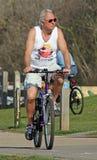 Cyclist on path Stock Photo