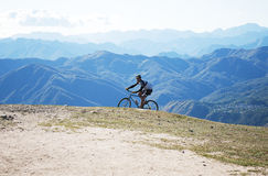 Cyclist on the peak of mountain Mottarone stock image
