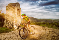 Cyclist pedaling through the hills. Stock Photos