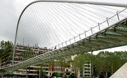 Cyclist and pedestrian bridge Zubi-Zuri in Bilbao Royalty Free Stock Image