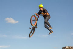 A cyclist performs a trick Stock Photography