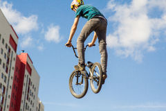 A cyclist performs a trick Royalty Free Stock Photo