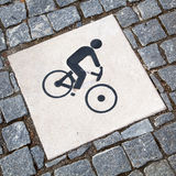 Cyclist pictogram. Pictogram of a cyclist on a bikeway from cobblestones Royalty Free Stock Photography