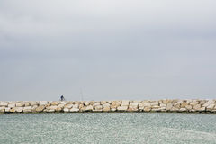 Cyclist on pier Royalty Free Stock Photography