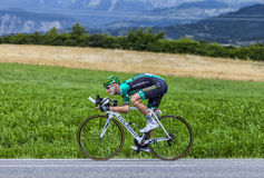 The Cyclist Pierre Rolland. Chorges, France- July 17, 2013: The French cyclist Pierre Rolland  from Team Europcar pedaling during the stage 17 of 100th edition Royalty Free Stock Photos